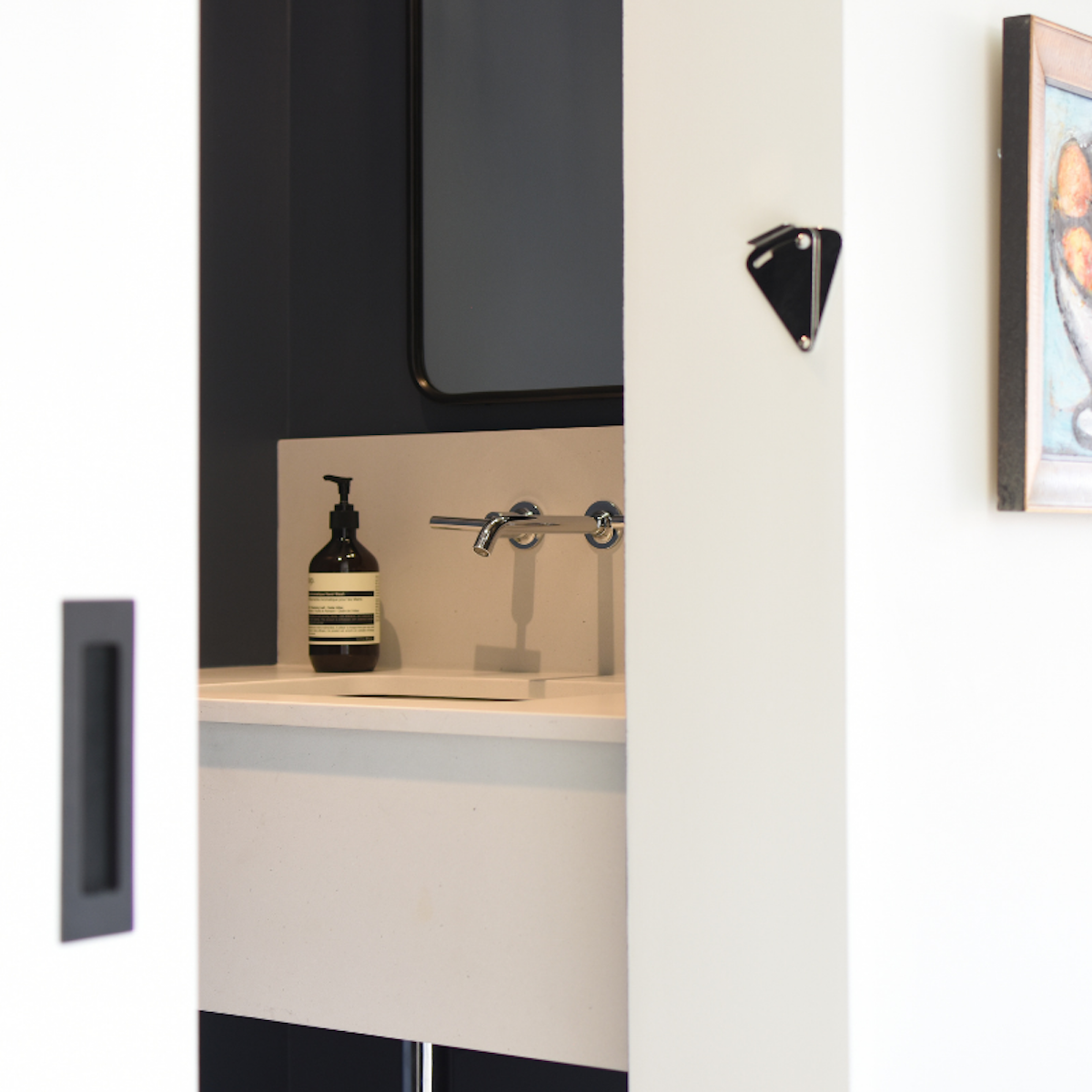 montreal-ca-powder-room-floating-sink-wall-mount-faucet-3