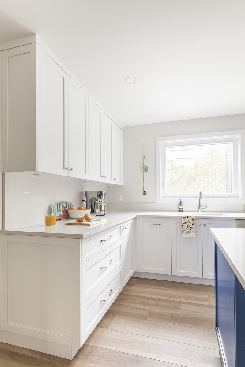 white-kitchen-blue-siland-wood-floors-3