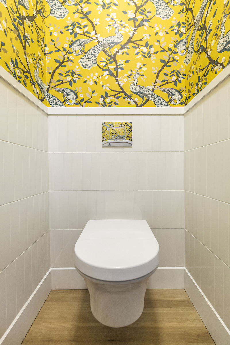 yellow-wallpaper-powder-room-wall-mount-toilet-vertical-subway-tile-3