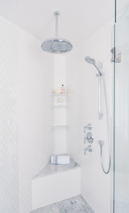 bathroom-shower-head-tile-walls-shower-seat